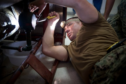 PUERTO BARRIOS, Guatemala (Feb. 8, 2017) - Construction Electrician 2nd Class Charles King, a native of Huntington Beach, Calif., assigned to Construction Battalion Mobile Unit (CBMU) 202, performs maintenance on a surgical equipment sterilization unit during a visit to a hospital in Puerto Barrios, Guatemala, in support of Continuing Promise 2017 (CP-17). CP-17 is a U.S. Southern Command-sponsored and U.S. Naval Forces Southern Command/U.S. 4th Fleet-conducted deployment to conduct civil-military operations including humanitarian assistance, training engagements, and medical, dental, and veterinary support in an effort to show U.S. support and commitment to Central and South America. (U.S. Navy photo by Mass Communication Specialist 2nd Class Shamira Purifoy)