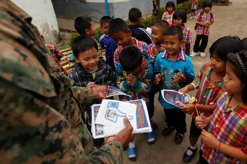 Students receive Cobra Gold stickers and coloring books from service members at Ban Nong Mee, Buri Ram Province, Thailand, during exercise Cobra Gold, Feb. 3, 2017. Marine Corps photo by Lance Cpl. Maximiliano Rosas