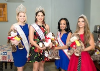 From left to right are Rose Buckley, International Ms. 2017; Elysa Acosta-Millan, Elite Miss Delaware 2017; Kimberly Phillips, Mrs. Camden Delaware America 2017; and Elissa Troise-Greco, Mrs. Lewes Delaware America 2017, at the Teddy-Grams for Troops event Feb. 10, 2017, at the USO on Dover Air Force Base, Del. The beauty queens volunteered their time to hand out Teddy-Grams and serve meals to Airmen and their families at the USO. (U.S. Air Force photo by Mauricio Campino)