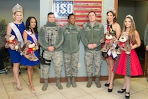 Beauty queens meet Team Dover Airmen at the Teddy-Grams for Troops event Feb. 10, 2017, at the USO on Dover Air Force Base, Del. From left to right are Rose Buckley, International Ms. 2017; Kimberly Phillips, Mrs. Camden Delaware America 2017; Airman Vincent Leal, 436th Security Forces Squadron flight operations journeyman; Capt. Jasmine Paul, 436th Comptroller Squadron Financial Services Flight commander; Master Sgt. David Devan, 436th Security Forces Squadron commercial vehicle inspection gate NCO in charge; Elysa Acosta-Millan, Elite Miss Delaware 2017, and Elissa Troise-Greco, Mrs. Lewes Delaware America 2017. (U.S. Air Force photo by Mauricio Campino)