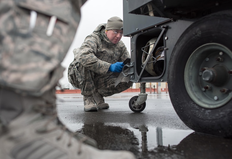 Staff Sgt. Steve Perron, 349th Aerospace Generation Equipment Flight mechanic, inspects an engine-driven generator Feb. 6, 2017, at Travis Air Force Base, Calif. Because generators can remain stationary and unused for significant periods of time, they must be periodically inspected to guard against low batteries, low tire pressure and fuel issues before they are delivered to aircraft mechanics on the flight line. This week hundreds of Citizen Airmen assigned to the 349th Maintenance Group are participating in Wrench Week, accomplishing ancillary training, upgrade training, and gaining practical experience necessary to sharpen their primary job skills. (U.S. Air Force photo by Ken Wright)