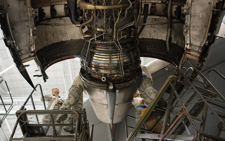 A crew of Citizen Airmen from the 945th Aircraft Maintenance Squadron at Travis Air Force Base, Calif., work together to replace C-17 Globemaster III engine panels, Feb. 10, 2017. The reservists were on duty to participate in Wrench Week 2017, which offers Citizen Airmen opportunities to reinforce and build their primary job skills. (U.S. Air Force photo by Ken Wright)