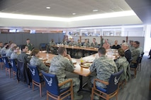Daniel Sitterly, Principal Deputy Assistant Secretary of the Air Force for Manpower and Reserve Affairs, speaks to annual award nominees during a luncheon Feb. 3, 2017, on Dover Air Force Base, Del. Sitterly ate and spoke with a mix of enlisted  and officers, about different areas of concerns for the Airmen. (U.S. Air Force photo by Staff Sgt. Jared Duhon)