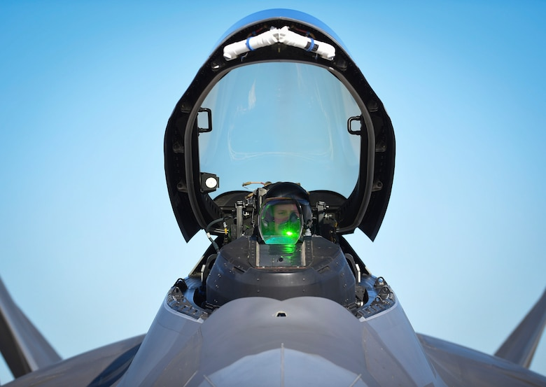 A 1st Fighter Wing F-22 Raptor pilot secures his helmet before takeoff during Red Flag 17-1 at Nellis Air Force Base, Nev., Jan 26, 2017. This is the first Red Flag in which Raptors are working alongside F-35A Lightning II's to secure air dominance and provide cover for fourth generation assets. (U.S Air Force photo by Staff Sgt. Natasha Stannard)