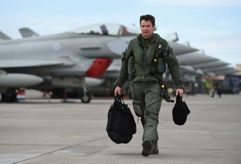 Royal Air Force Flight Lt. Jonny Mulhall, 6th Squadron Eurofighter Typhoon pilot, walks to his aircraft during Red Flag 17-1 at Nellis Air Force Base, Nev., Feb. 7, 2017. The Royal Air Force and Australian Air Force participated in 17-1 alongside their U.S. partners to enhance tactics, techniques and procedures in air, space and cyber domains. (U.S Air Force photo by Staff Sgt. Natasha Stannard)