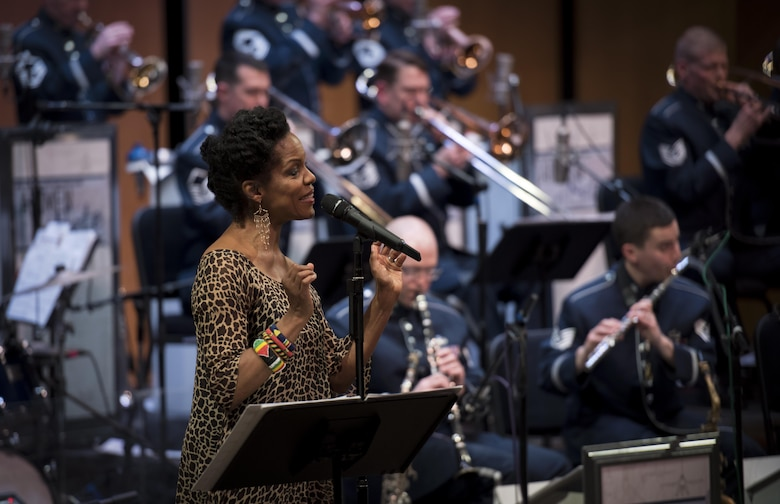 Nnenna Freelon, vocalist, sings alongside the U.S. Air Force Band Airmen of Note during a 2017 Jazz Concert Series performance at the Rachel M. Schlesinger Concert Hall and Arts Center in Alexandria, Va., Feb. 9, 2017. Freelon, a six-time Grammy nominee, has toured with many jazz artists, including Ellis Marsalis and Ray Charles. (U.S. Air Force photo by Airman 1st Class Gabrielle Spalding)