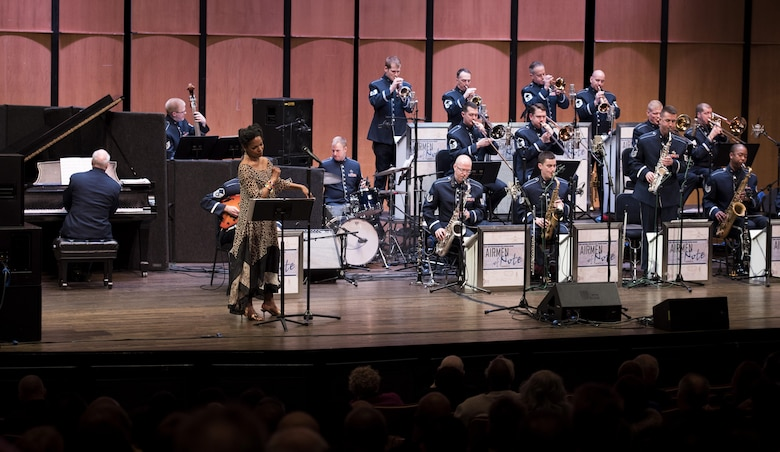 Nnenna Freelon, vocalist, sings alongside the U.S. Air Force Band Airmen of Note during a 2017 Jazz Concert Series performance at the Rachel M. Schlesinger Concert Hall and Arts Center in Alexandria, Va., Feb. 9, 2017. The concert series began in 1990 and has showcased many notable jazz musicians, including pianist Cyrus Chestnut, trumpeter Terell Stafford and saxophonist Kirk Whalum. (U.S. Air Force photo by Airman 1st Class Gabrielle Spalding)