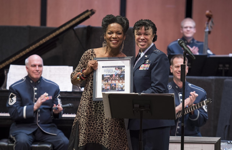 "Nnenna Freelon, vocalist, receives a token of appreciation from Lt. Gen. Stayce D. Harris, Headquarters U.S. Air Force assistant vice chief of staff, during a 2017 Jazz Concert Series performance at the Rachel M. Schlesinger Concert Hall and Arts Center in Alexandria, Va., Feb. 9, 2017. Throughout the night's performance Freelon sang her version of many recognizable jazz tunes, including the Nina Simone song ""Feeling Good.""  (U.S. Air Force photo by Airman 1st Class Gabrielle Spalding)"