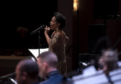 Nnenna Freelon, vocalist, sings alongside the U.S. Air Force Band Airmen of Note at the Rachel M. Schlesinger Concert Hall and Arts Center in Alexandria, Va., Feb. 9, 2017. This performance was part of the Jazz Heritage Concert Series, which will take place throughout the year and feature various notable jazz musicians. (U.S. Air Force photo by Airman 1st Class Gabrielle Spalding)