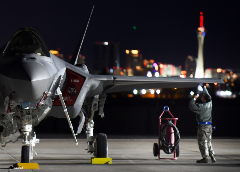 A maintainer with the 388th Fighter Wing out of Hill Air Force Base, Utah, checks for structural damages on an F-35A Lightning II during Red Flag 17-1 at Nellis Air Force Base, Nev., Jan. 25, 2017. For most non-structural and all structural repairs, low observable aircraft structure technicians must either fix the paneling damage or remove paneling for maintainers to repair other issues. (U.S. Air Force photo by Staff Sgt. Natasha Stannard)