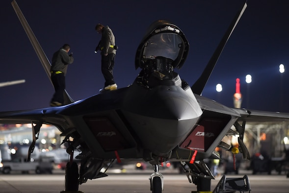 Maintainers with the 27th Aircraft Maintenance Unit out of Joint Base Langley-Eustis, Va., check for structural damages on an F-22 Raptor during Red Flag 17-1 at Nellis Air Force Base, Nev., Jan. 27, 2017. If damages are found, low observable aircraft structure technicians must repair them to ensure the aircraft maintains its stealth capability. (U.S. Air Force photo by Staff Sgt. Natasha Stannard)