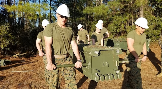 On February 8, 2017, Marines attached to Combat Engineer Officer course 2-17 (CEO 2-17) remove a top panel from the Medium Girder Bridge after retrieving the bridge out of the gap. During their period of instruction, CEO students learn how to plan for and construct a Medium Girder Bridge.  Pictured from left to right:  Second Lieutenants Mitch Bottini, Kerri Hands, and Manuel Ramirez.