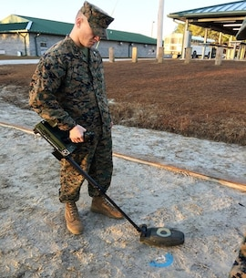 On January 13, 2017  Second Lieutenant Clark Kreitzer, a Marine attached to Combat Engineer Officer course 1-17 (CEO 1-17); practices using a  VMR-2 Minehound. The VMR-2 is a compact , dual sensor explosive hazard detector. This device is designed for the detection of buried or submerged high metallic, low metallic, and non-metallic explosive hazards. This piece of equipment is particularly important because of its ability to detect enemy IED's, which have become the largest threat to our military forces.