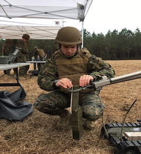 On February 3, 2017 Second Lieutenant Andrew Mullen, a Marine attending Combat Engineer Officer course 1-17 (CEO 1-17); places a four pound charge in the grippers of a robot and ensures that it is secure. The four blocks of C4 are taped together and a carrying handle is made with tape and a small stick so the robot has a steady grip on the explosive charge while carrying it down range to the explosive hazard.