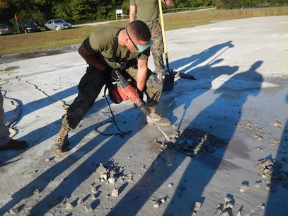 On October 18, 2016 Second Lieutenant Kristopher Satterwhite, a Marine attached to Combat Engineer Officer course 1-17 (CEO 1-17); uses an electric hammer drill to clear out concrete from a spall that has been cut out. This must be done before the damaged area can be resurfaced. Engineers need to be proficient in airfield damage repair so that airfield operations can are uninterrupted.