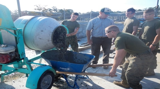 On October 28, 2016 Marines attached to Combat Engineer Officer course 1-17 (CEO 1-17) learn how to operate a concrete mixer to mix and pour concrete. Engineers need to calculate the right mixture proportions of sand, gravel, cement, and water in order to produce strong and durable concrete. Pictured from left to right:  Second Lieutenant Kameron Olsen, Mr. Eric Schnitzler, Second Lieutenants William Burton, Jonathan Neltner, and Jacob Petersen.
