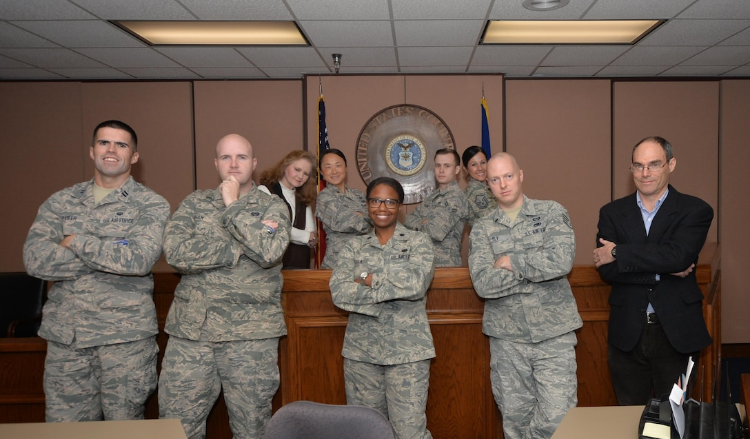 U.S. Air Force Airmen from the 325th Fighter Wing Staff Judge Advocate office pose for a group photo at Tyndall Air Force Base, Fla., Feb. 14, 2017. The SJA office recently completed the second part of an Article 6 Inspection earning an overall excellent rating. (U.S. Air Force photo by Tech. Sgt. Javier Cruz/Released)