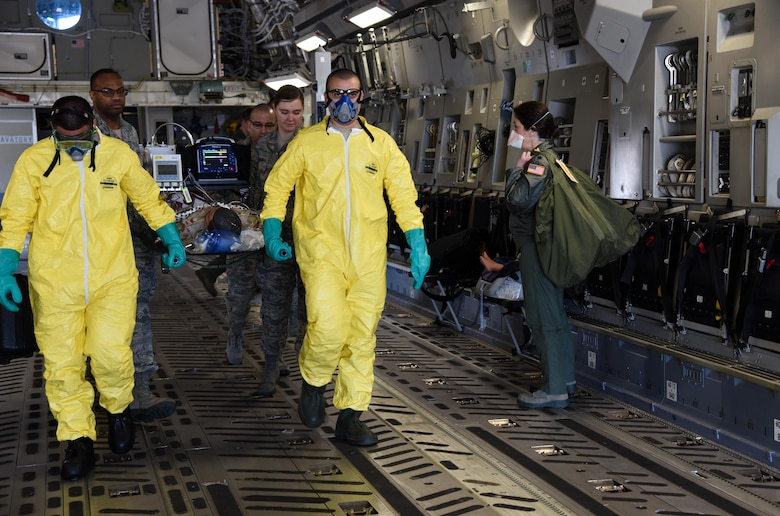 349th Aeromedical Staging Squadron Citizen Airmen litter carry simulated tuberculosis patients during a scenario for exercise Patriot Wyvern at Travis Air Force Base, Calif., Feb. 11, 2017. ASTS is responsible for the loading and unloading patients from aircraft and administering medical care. (U.S. Air Force photo by Senior Airman Sam Salopek)