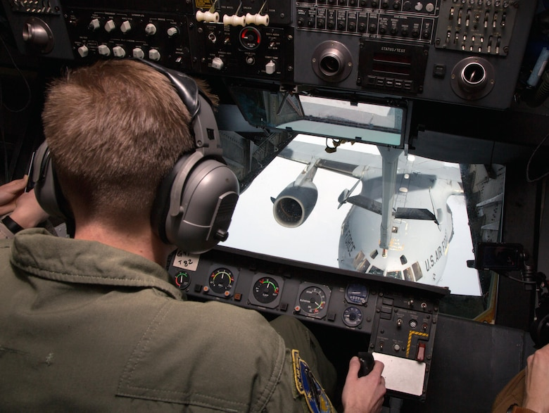 Staff Sgt. Jeremy Rigg, a KC-10A Extender air refueling boom operator, 70th Air Refueling Squadron, practices refueling a C-17 Globemaster III over the Pacific Ocean Feb. 14, 2017.  The drill-weekend training was part of the 349th Air Mobility Wing's Patriot Wyvern exercise, which emphasized hands-on job skills training. (U.S. Air Force photo by Lt. Col. Robert Couse-Baker)