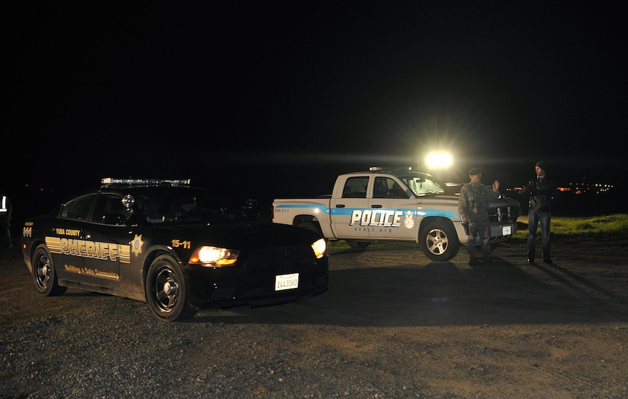 The 9th Security Forces Squadron coordinates with the Yuba County Sheriff's Office to provide evacuees shelter in response to the Oroville spillway evacuation notice at Beale Air Force Base, California, Feb. 12, 2017. Beale hosted approximately 400 evacuees from surrounding communities. (U.S. Air Force photo/Airman Tristan D. Viglianco)