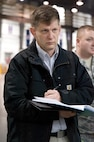 Mr. William Adams, a scientist with the Navy Center for Applied Research in Artificial Intelligence, Washington, D.C., takes notes on the inbound freight processing procedures used by the 436th Aerial Port Squadron truck dock personnel Feb. 7, 2017, at Dover Air Force Base, Del. Williams was part of an Air Mobility Command military and civilian study team that observed many facets of the Super Port during their four-day visit. (U.S. Air Force photo by Roland Balik)