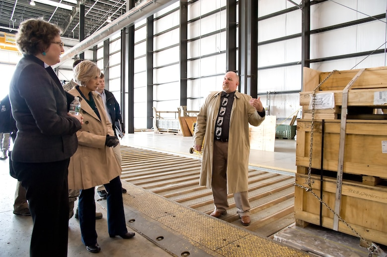 """Dr. Donna Senft, Air Mobility Command chief scientist, left, and Sara Keller, AMC Logistics, Engineering, Force Protection deputy director, both assigned to Scott Air Force Base, Ill., listen to Jim Ewing, 436th Aerial Port Squadron operations manager, explain pallet build up and processing of oversized cargo by aerial port personnel Feb. 7, 2017, at Dover Air Force Base, Del. Senft and Keller were part of AMC's """"Aerial Port of the Future"""" study team that observed practices and procedures used by Super Port personnel. (U.S. Air Force photo by Roland Balik)"""