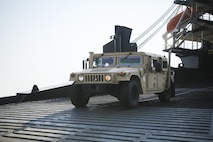 A U.S. Marine with Combat Logistics Battalion 4, drive a High Mobility Multipurpose Wheeled Vehicle off the USNS Fred W. Stockham, during exercise Cobra Gold, at Laem Chabang International Terminal, Thailand, Feb. 11, 2017. Cobra Gold, in its 36th iteration, is an important element of the United States' and all other participating nations' regional military to military engagement efforts. (U.S. Marine Corps photo by Cpl. Wesley Timm)