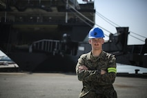 U.S. Marine Corps Cpl. James Whittington, a landing support specialist with Combat Logistics Battalion 4, takes a break from offloading tactical vehicles from the USNS Gunnery Sgt. Fred W. Stockham, during exercise Cobra Gold, at Laem Chabang International Terminal, Thailand, Feb. 11, 2017. Cobra Gold, in its 36th iteration, is an important element of the United States' and all other participating nations' regional military to military engagement efforts. (U.S. Marine Corps photo by Cpl. Wesley Timm)