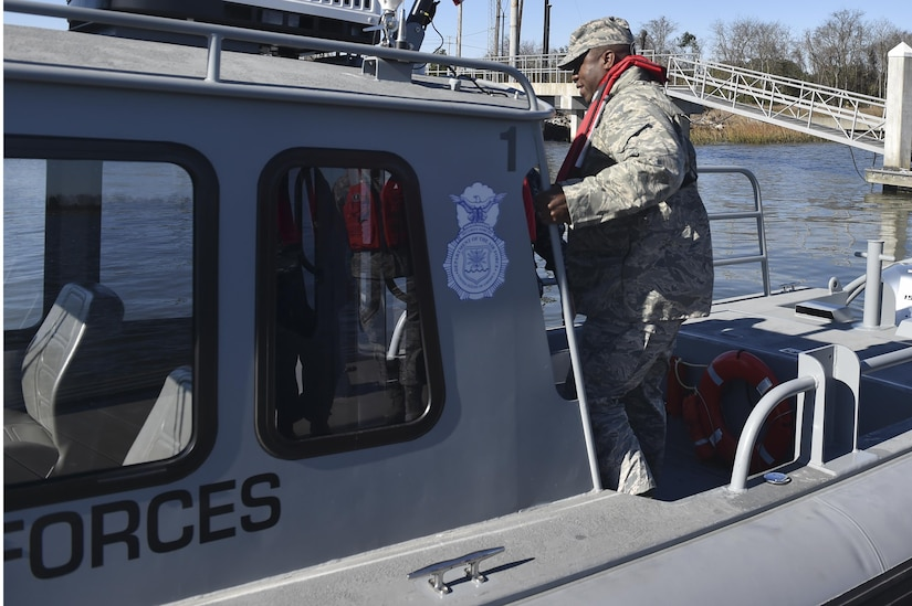 U.S. Air Force Brig. Gen. Stacey T. Hawkins, Air Mobility Command Logistics, Engineering and Force Protection director, boards a boat Feb. 10, 2017, at Joint Base Charleston -- Naval Weapons Station, South Carolina. Hawkins visited multiple facilities on JB Charleston during his visit to meet with Airmen and senior leaders to discuss operations.
