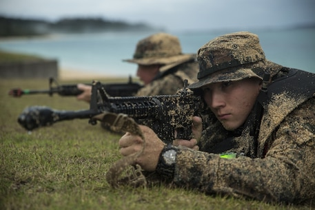 Lance Cpl. James P. Nelson, a scout swimmer with Fox Company, Battalion Landing Team, 2nd Battalion, 5th Marines, provides security during a boat raid at Camp Hansen, Okinawa, Japan, Jan. 12, 2017. Marine Expeditionary Unit Exercise is the first in a series of pre-deployment training events to prepare the 31st MEU for the upcoming 2017 Spring Patrol. As the Marine Corps' only continuously forward deployed unit, the 31st MEU's air-ground-logistics team provides a flexible force, ready to perform a wide range of military operations, from limited combat to humanitarian assistance operations, throughout the Indo-Asia-Pacific region. (U.S. Marine Corps photo by Lance Cpl. Breanna L. Weisenberger)