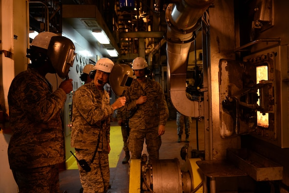 U.S. Air Force Gen. Terrence O'Shaughnessy, Pacific Air Forces commander, and Chief Master Sgt. Anthony Johnson, Pacific Air Forces command chief, observe operations during a tour of the Central Heat and Power Plant (CHPP) during a base visit at Eielson Air Force Base, Alaska, Feb. 8, 2017. The CHPP uses about 180,000 tons of coal to provide heat and electricity for the Eielson mission and its residents year round. (U.S. Air Force photo by Airman 1st Class Cassandra Whitman)