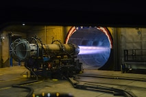 """A gas turbine engine from a U.S. Air Force F-16C Fighting Falcon, assigned to the New Jersey Air National Guard's 177th Fighter Wing at the Atlantic City Air National Guard Base in Egg Harbor Township, N.J., is tested at full afterburner in the engine test cell facility, also known as the """"Hush House"""" on Jan. 31, 2017. The General Electric F110-GE-100 turbofan, produces close to 29,000 pounds of static thrust in afterburner, which can propel the Fighting Falcon to approximately twice the speed of sound. (U.S. Air National Guard photo by Master Sgt. Andrew J. Moseley/Released)"""