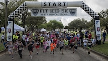 JBSA - Runners take off from the starting line during the Fit Kid 5K and Health Fair March 12 at Heritage Park on Joint Base San Antonio-Randolph. The Fit Kid 5K and Health Fair is part of National Nutrition Month that aims to teach children healthy habits related to nutrition and fitness.