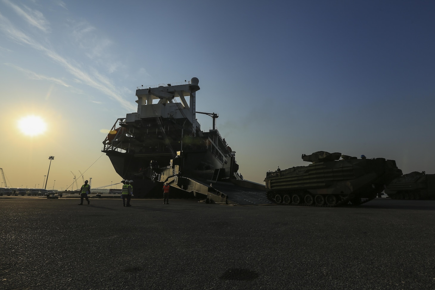 U.S. Marines with Combat Logistics Battalion 4 offload an Assault Amphibious Vehicle from the USNS Gunnery Sgt. Fred W. Stockham, during exercise Cobra Gold, at Laem Chabang International Terminal, Thailand, Feb. 11, 2017. Cobra Gold, in its 36th iteration, is an important element of the United States' and all other participating nations' regional military to military engagement efforts. (U.S. Marine Corps photo by Cpl. Wesley Timm)