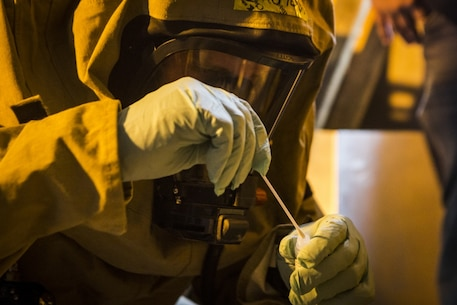 Cpl. Ryan Yancey, a chemical, biological, radiological and nuclear (CBRN) defense specialist with the CBRN response element (CRE), 31st Marine Expeditionary Unit, collects a sample from a mock contaminated environment during CBRN response training at Camp Hansen, Okinawa, Japan, Feb. 1, 2017. The CRE conducted full scale detection and decontamination training with Marine Corps Installations Pacific - Fire and Emergency Services personnel observing. As the Marine Corps' only continuously forward-deployed unit, the 31st MEU air-ground-logistics team provides a flexible force, ready to perform a wide range of military operations, from limited combat to humanitarian assistance operations, throughout the Indo-Asia Pacific region. (U.S. Marine Corps photo by Cpl. Darien J. Bjorndal/ Released)