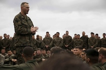 Lt. Col. Michael Ogden, commanding officer of Battalion Landing Team 2nd Battalion, 5th Marines, addresses Marines and Sailors with BLT 2/5, Combat Logistics Battalion 31 and Marine Medium Tiltrotor Squadron 262 (Reinforced) on the flight deck of the USS Green Bay (LPD 20), Pacific Ocean, Feb. 3, 2017. Detachments from the air, ground and logistics combat elements of the 31st Marine Expeditionary Unit embarked Feb. 1, 2017 as a part of the MEU's 17.1 Spring Patrol. The air-ground task force concept is designed to thoroughly exploit the combat power inherent in air and ground assets by closely integrating them into a single force under one commander. The size and composition of the MEU makes it well suited for amphibious operations, security operations, noncombatant evacuation operations, humanitarian assistance operations and special operations. (U.S. Marine Corps photo by Sgt. Tiffany Edwards/Released)