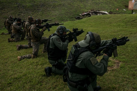 Marines with Maritime Raid Force, 31st Marine Expeditionary Unit, fire weapons with Guam Police Department officers and SWAT team members at Anderson Air Force Base, Guam, Feb. 7, 2017. The MRF Marines trained with the police officers and SWAT team members as a gesture of good will between the two forces. As the Marine Corps' only continuously forward-deployed unit, the 31st Marine Expeditionary Unit's air-ground-logistics team provides a flexible force, ready to perform a wide range of military operations, from limited combat to humanitarian assistance operations, throughout the Indo-Asia-Pacific region. (U.S. Marine Corps photo by Lance Cpl. Jorge A. Rosales/ Released)