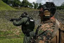 Sgt. Luis Martinez, a reconnaissance Marine, with Maritime Raid Force, 31st Marine Expeditionary Unit, conducts a live-fire range with police officers and SWAT members of the Guam Police Department at Anderson Air Force Base, Guam, Feb. 7, 2017. The MRF Marines trained with the police officers and SWAT team members as a gesture of good will between the two forces.  As the Marine Corps' only continuously forward-deployed unit, the 31st Marine Expeditionary Unit's air-ground-logistics team provides a flexible force, ready to perform a wide range of military operations, from limited combat to humanitarian assistance operations, throughout the Indo-Asia-Pacific region. Martinez is a native of Powder Springs, Georgia. (U.S. Marine Corps photo by Lance Cpl. Jorge A. Rosales/ Released)