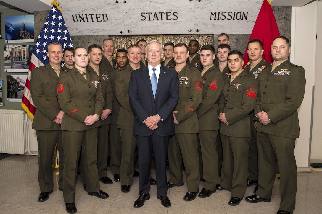 Defense Secretary Jim Mattis, center, poses for a photograph after meeting with Marines assigned to the NATO mission at NATO headquarters in Brussels.