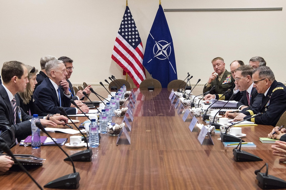 Defense Secretary Jim Mattis, center left, meets with members of the U.S. mission at NATO headquarters.