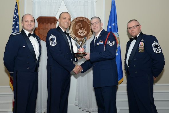 U.S. Air Force Staff Sgt. Daniel Rice, 31st Intelligence Squadron, receives the John L. Levitow Award for the Senior Master Sgt. David B. Reid Airman Leadership School Class 17-2, from Chief Master Sgt. Richard Skrabak, 20th Comptroller Squadron superintendent, at Shaw Air Force Base, S.C., Feb. 9, 2017. The Levitow Award is given to the graduate with the highest average of instructor and student points, and is the highest award in enlisted professional military education. (U.S. Air Force photo by Airman 1st Class Kelsey Tucker)