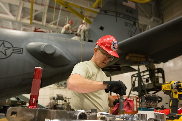 U.S. Air Force Master Sgt. Brent Rose, a repair and reclamation specialist assigned to the 139th Maintenance Squadron, Missouri Air National Guard, wipes down a bolt from a C-130 Hercules aircraft at Rosecrans Air National Guard Base, St. Joseph, Mo., Feb. 7, 2017. Rose was assisting with aircraft maintenance that required the removal of the vertical stabilizer, or tail, of the aircraft. (U.S. Air National Guard photo by Master Sgt. Michael Crane)