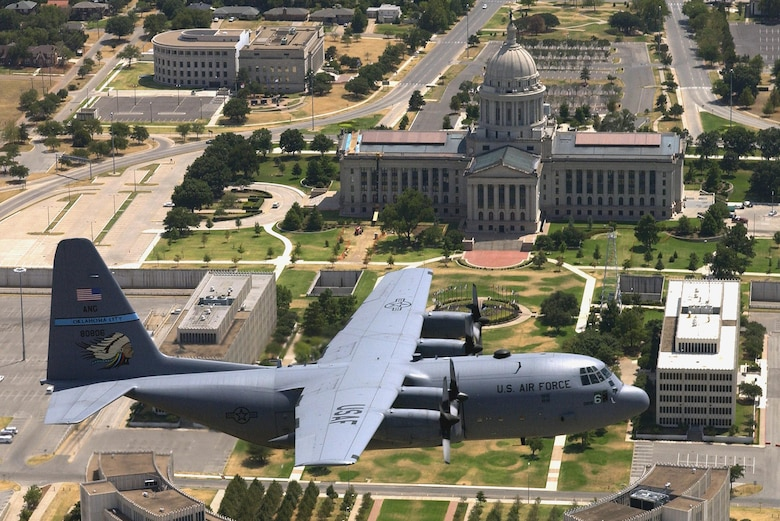 A C-130 Hercules from the 137th Airlift Wing flies over the Oklahoma State Capitol, Aug. 14, 2006.