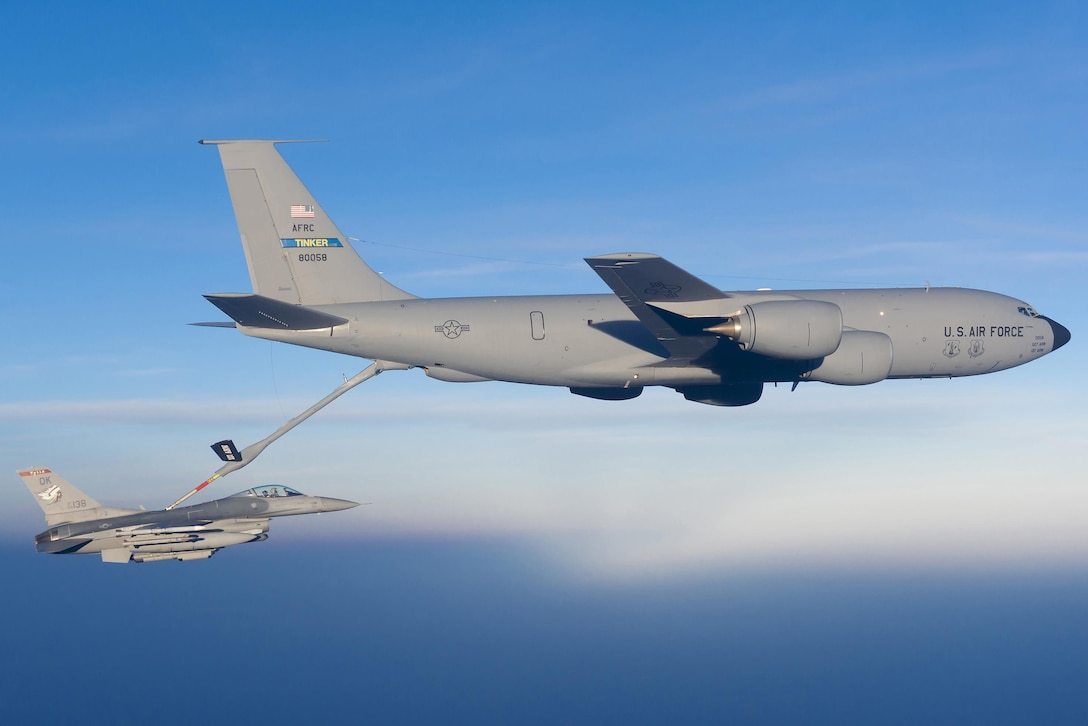 An F-16 Fighting Falcon from the 138th Fighter Wing, Tulsa Air National Guard, is refueled by a KC-135 from the 185th Air Refueling Squadron, 137th Air Refueling Wing, from Tinker Air Force Base during a training mission, May 4, 2015.  (U.S. Air National Guard photo by Master Sgt. Mark A. Moore/Released)