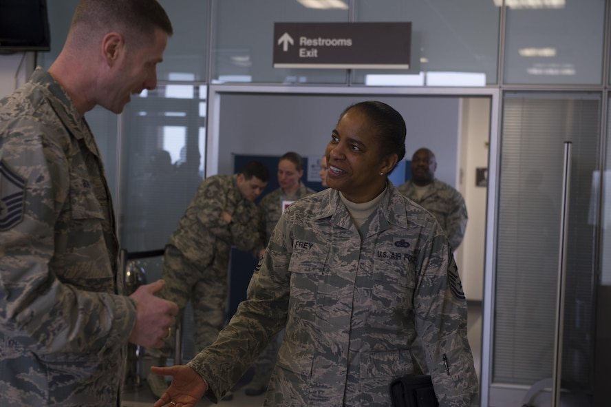 Chief Master Sgt. Shelina Frey, Air Mobility Command command chief, greets Airmen as she arrives at the 726th Air Mobility Squadron at Spangdahlem Air Base, Germany, Feb. 13, 2017. Frey visited with AMC Airmen stationed at both Ramstein Air Base and Spangdahlem Air Base, Germany during her visit. The 726th Air Mobility Squadron provides air transportation, cargo, maintenance and enroute support to Allied and American forces. (U.S. Air Force photo by Senior Airman Dawn M. Weber)