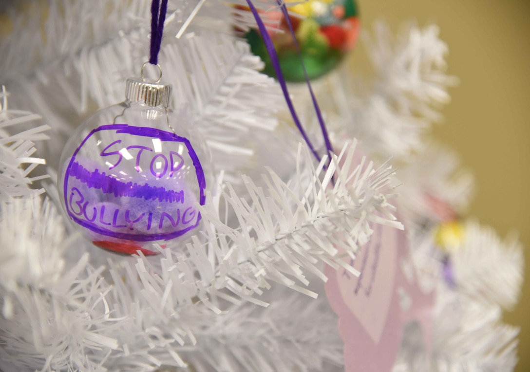 A remembrance tree with 25 ornaments displaying facts about Teen Dating Violence Awareness Month is located in McConnell's Youth Center during the month of February. Children created their own ornaments in recognition of the observance. (U.S. Air Force photo/Airman 1st Class Erin McClellan)