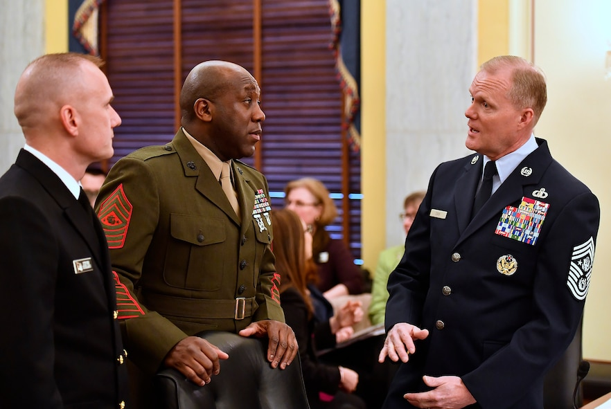 Chief Master Sgt. of the Air Force James A. Cody speaks with Master Chief Petty Officer of the Navy Steven Giordano and Sgt. Maj. of the Marine Corps Ronald L. Green before testifying at the Senate Armed Services Subcommittee on Personnel in Washington, D.C., Feb. 14, 2017. In his comments, Cody talked about compensation and growing the force.  This is the last Congressional hearing for Cody before he retires from the Air Force.  (U.S. Air Force photo/Scott M. Ash)