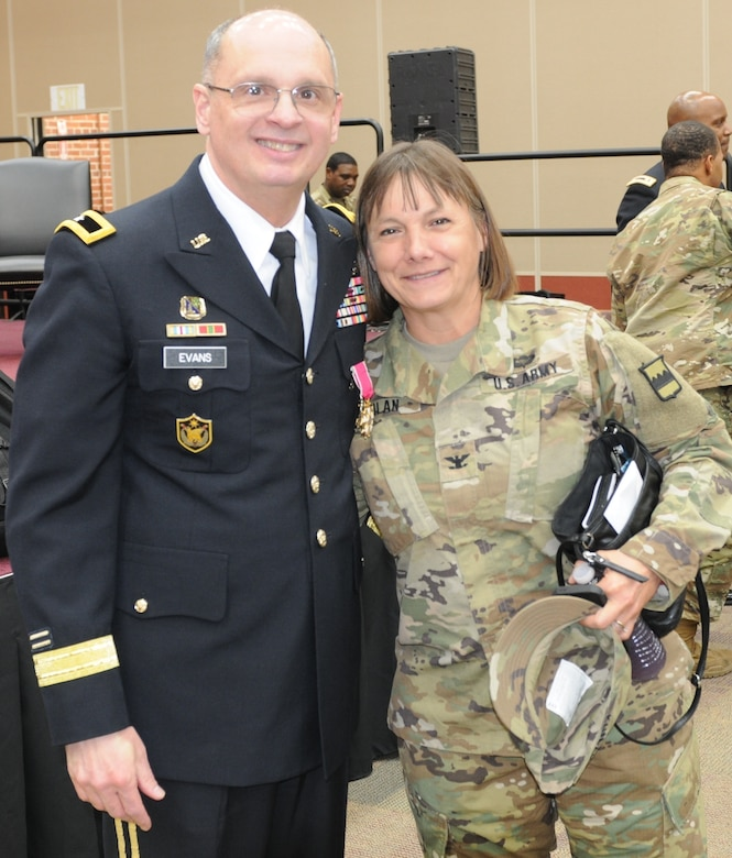 Brig. Gen. Thomas P. Evans, deputy commanding general of the 80th Training Command, shares a goodbye hug with Col. Susie S. Kuilan, chief of staff of the 80th TC, at Evans' retirement ceremony at the Defense Supply Center in Richmond, Virginia, Feb. 11, 2017. (Photo by Master Sgt. Stacey Everett, 80th Training Command Headquarters and Headquarters Company)