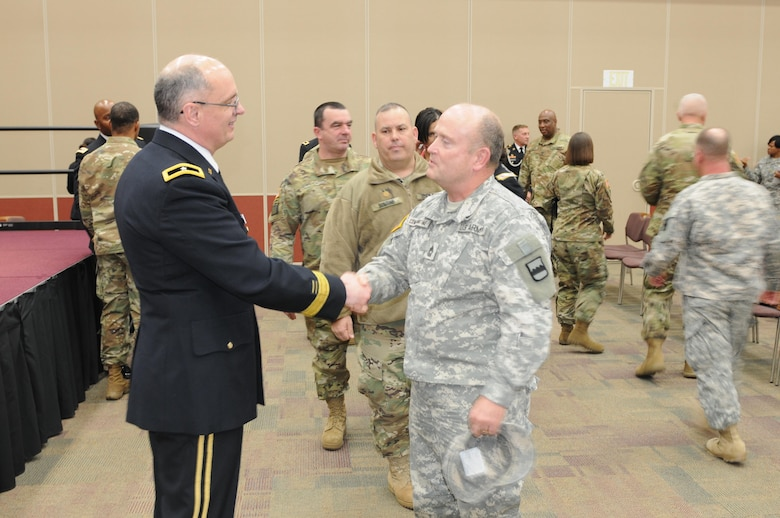 Brig. Gen. Thomas P. Evans, deputy commanding general of the 80th Training Command, says goodbye to Master Sgt. Jeff Constantine, of the 80th's Systems Integration Management Office, at Evans' retirement ceremony at the Defense Supply Center in Richmond, Virginia, Feb. 11, 2017. (Photo by Master Sgt. Stacey Everett, 80th Training Command Headquarters and Headquarters Company)