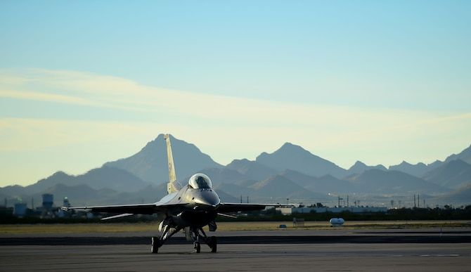 An F-16 Viper taxies after flying during the 2017 Heritage Flight Training and Certification Course at Davis-Monthan Air Force Base, Ariz., Feb. 11, 2017. The F-16 Viper was joined by several aircraft, including the F-22 Raptor, F-35 Lightning II and the A-10C Thunderbolt II during the 20th annual demonstration training. (U.S. Air Force Photo by Senior Airman Kimberly Nagle)